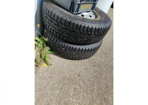 BARELY USED SNOW STUDDED TIRES FIRESTONE